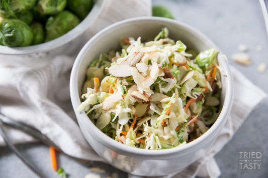 Coleslaw with Shaved Brussels Sprouts and Almonds // This crunchy, tangy coleslaw is taken to the next level with shaved brussels sprouts and sliced almonds - Healthy never tasted so good!   Tried and Tasty.