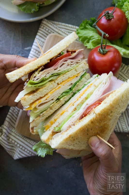Triple Decker Deli Sandwich // This is the sandwich of all sandwiches that you WILL want to have all summer long! Lunch won't be the same again with this delicious triple decker threat! You'll want to stop by to see the secret ingredient |Tried and Tasty