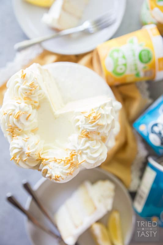 Lemon Lovers Ice Cream Cake // Calling all lemon lovers, this ice cream cake screams summer with the most delicious lemon cake sandwiched between a layer of lemon ice cream and a layer of vanilla bean ice cream covered in light and fluffy lemon whipped cream frosting!   Tried and Tasty